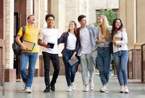 Fotografía Multiracial students walking after classes in university campus
