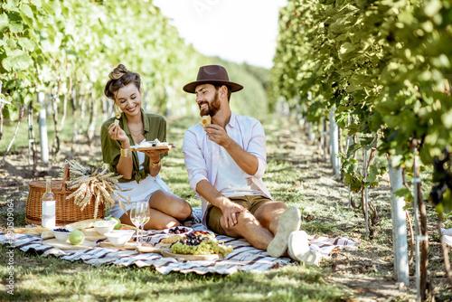 Carta da parati Beautiful couple having romantic breakfast with lots of tasty food and wine, sit