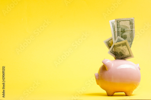 Fotografija Piggy bank isolated on yellow background. Savings concept