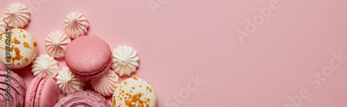 Fotografie, Obraz Top view of gourmet pink macaroons, assorted meringues and soft zephyr on pink b