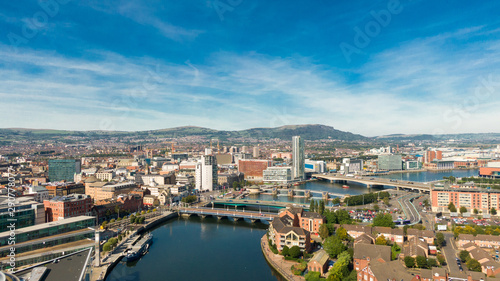 Obraz na plátně Aerial view on river and buildings in City center of Belfast Northern Ireland