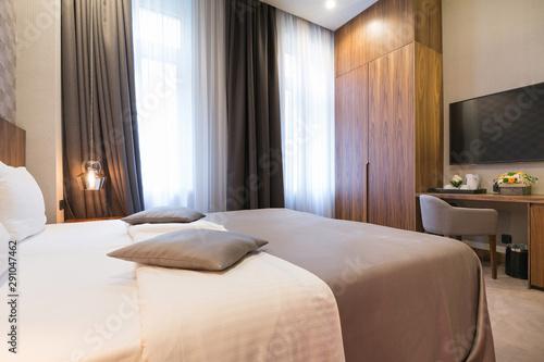 Fototapeta Hotel bedroom interior in the morning