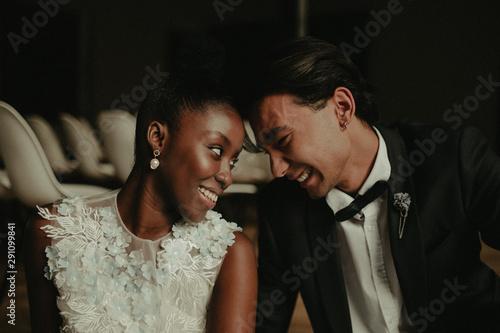 Fototapeta Bride and groom hug each other