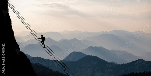 Fototapeta Courageous climb for high altitude mountaineering and professional climber