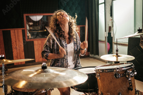 Fotografering Woman playing drums during music band rehearsal