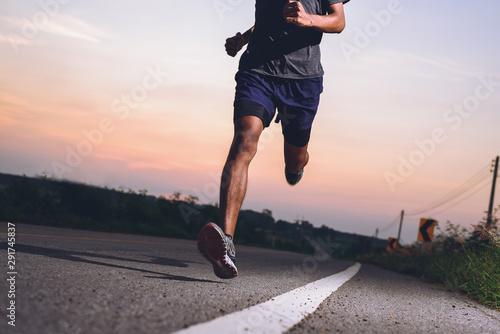 Wallpaper Mural Athlete runner feet running on road, Jogging concept at outdoors