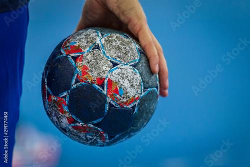 Fototapeta Handball players hand holding the ball