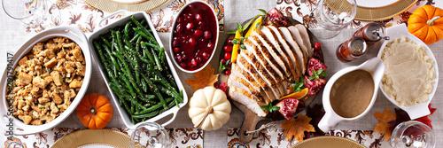 Fotografie, Obraz Thanksgiving dinner table, overhead shot, long banner