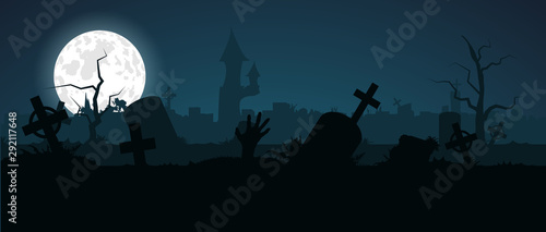 Fotografija Halloween zombie hand crawls out of a grave in an old abandoned cemetery