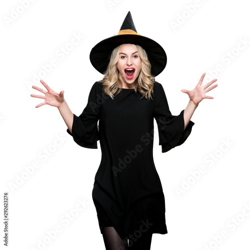 Vászonkép Attractive young woman dressed in witch halloween costume isolated over white background
