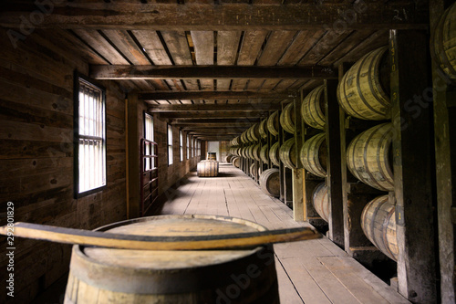 Fotografia Distillery whiskey wooden barrel container room factory in Kentucky, USA