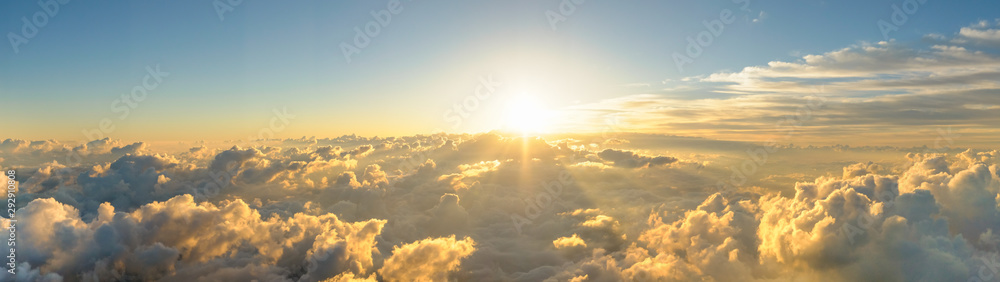 Panorama sunrise from the top of the mount Fuji. The sun is shining strong from the horizon over all the clouds and under the blue sky. good New year new life new beginning. Abstract nature background
