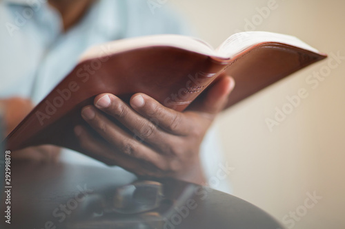African American man praying and reading the Bible. Fototapete