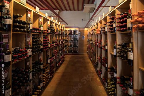 Fotografie, Tablou Interior of a wine shop in Saint Emilion in France