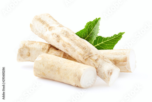 Fotografiet Horseradish root with leaves on white background