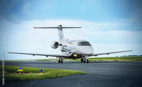 Fotografia Modern airplane parked on runway