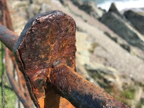 Canvastavla Rusty railing on the coast in Greystones near Dublin Ireland