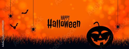 Fotografiet orange halloween banner with pumpkin spider and bats