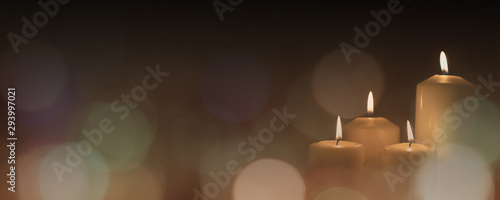 Obraz na plátně Christmas advent candle light in church with blurry golden bokeh for religious r
