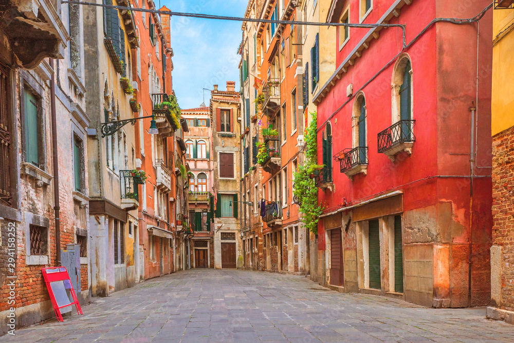 Colorful houses in the old medieval street in Venice, Italy
