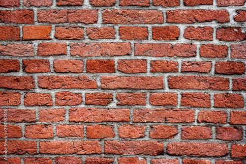 Red old brick wall on vintage houses Fototapeta