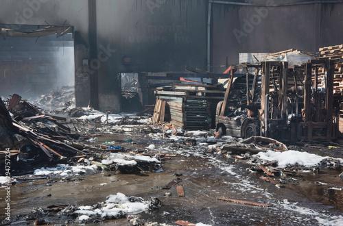 Twisted burnt rubble from a warehouse fire Fototapeta