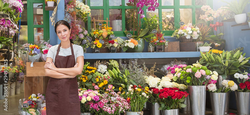 Startup successful sme small business entrepreneur owner asian woman standing with flowers at florist shop. Portrait of caucasian girl successful owner environment friendly concept banner