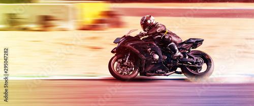 Obraz na plátně motorcycle racer rides on a sports track