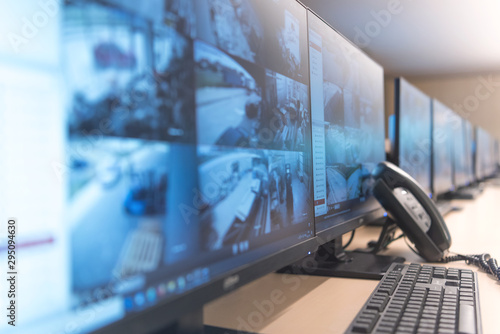 Fotografie, Obraz Security guard monitoring modern CCTV cameras in surveillance room