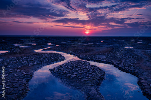 August sunset over the mud flaps and sand of Snettisham beach on the North Norfo Fototapeta