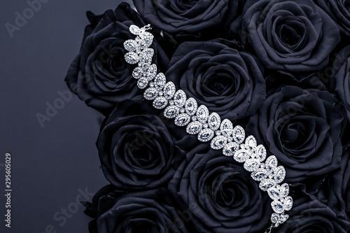 Fényképezés Luxury diamond jewelry bracelet and black roses flowers, love gift on Valentines