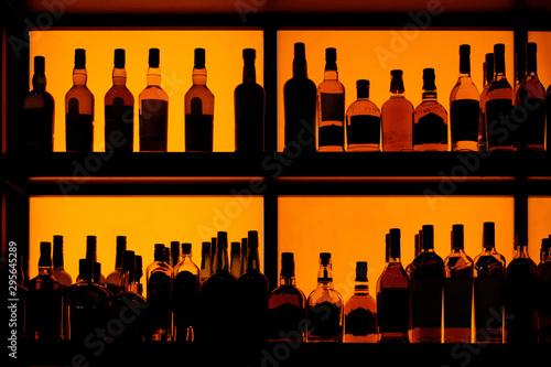 Bottles sitting on shelf in a bar