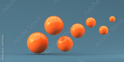 Fotografía Falling orange balls in the blue background