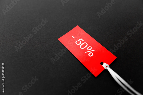 shopping, sale and outlet concept - red tags with discount signs on black backgr Fototapeta