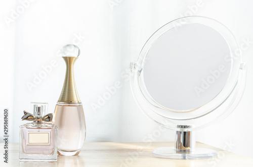 Fotografie, Tablou Luxury perfume bottles on wooden dressing table.