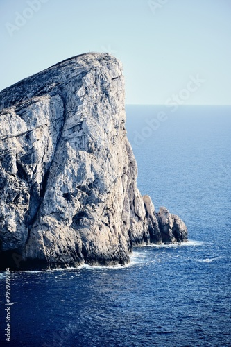 Obraz na płótnie Cliff near the sea with a blue sky