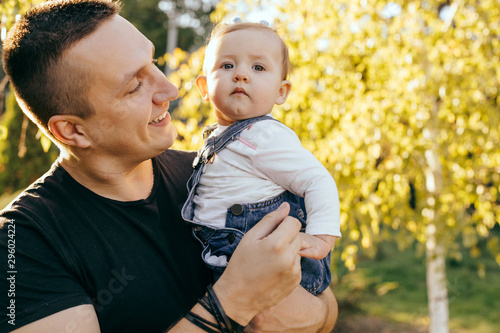 Fotografija Happy younfather and her child enjoy the sunset outdoor  - Image
