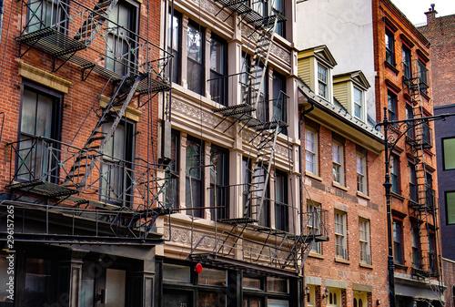Obraz na płótnie New York City East village buildings with fire escapes
