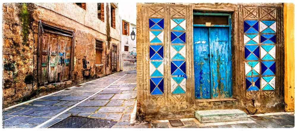 Urocze stare kolorowe ulice Grecji, miasto Rethymno na Krecie <span>plik: #296196622   autor: Freesurf</span>