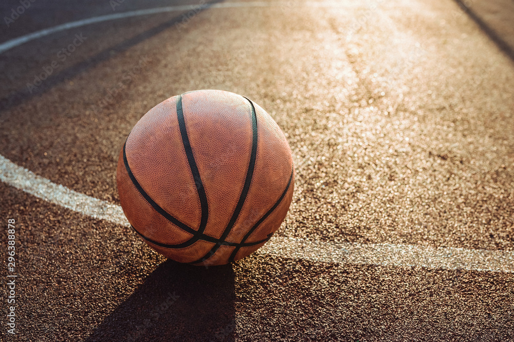 Basketball ball on urban court. Healthy lifestyle and sport concepts.