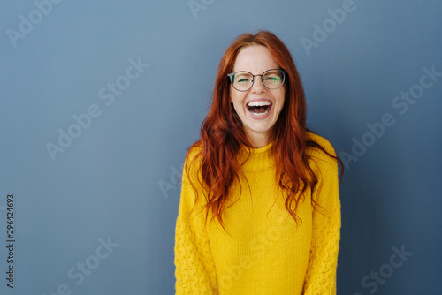 Fotografia Young redhead woman with lovely sense of humor