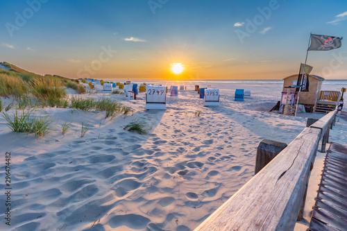 Photo Sunset at the beach on Juist, East Frisian Islands, Germany.
