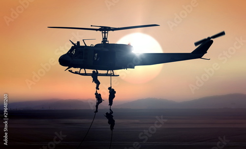 Canvas Print Military commandos helicopter drops during sunrise