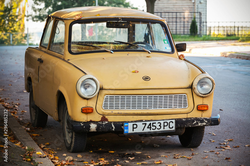 Canvas Print Old yellow Trabant 601s car on the street