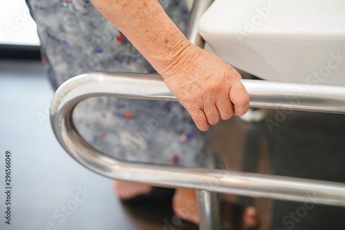 Wallpaper Mural Asian senior or elderly old lady woman patient use toilet bathroom handle security in nursing hospital ward : healthy strong medical concept
