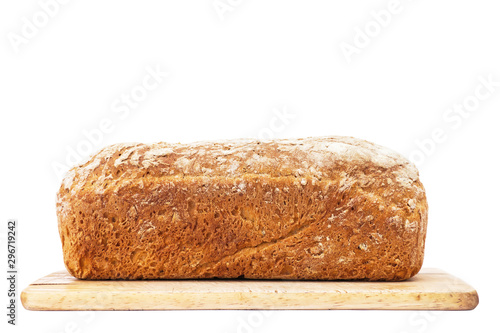 Fotografering Loaf of bread on cutting board isolated on white
