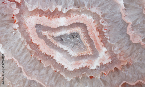 Close up of a polished slice of quartz and banded agate.