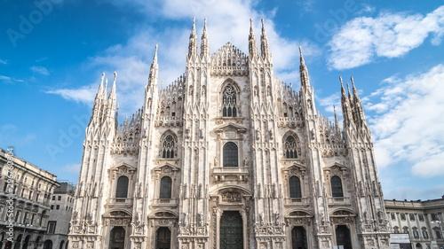 Photo Duomo di Milano, Gothic facade of Milan Cathedral  Church -  frontal breathtakin