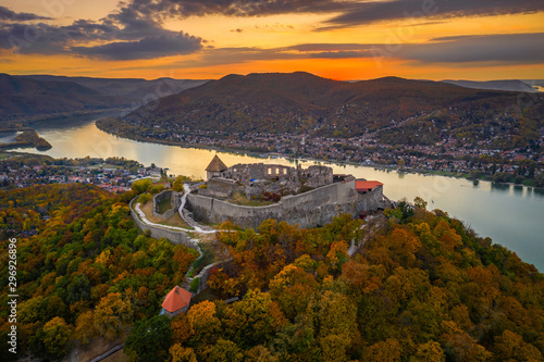 Fototapeta Visegrad, Hungary - Aerial drone view of the beautiful high castle of Visegrad with autumn foliage and trees