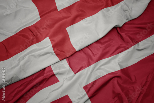 waving colorful flag of denmark and national flag of england. Poster Mural XXL